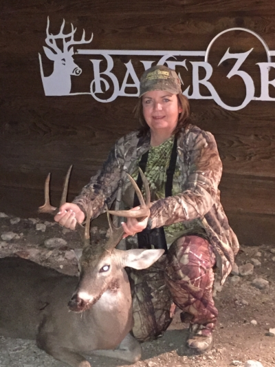 Woman enjoying whitetail deer hunt