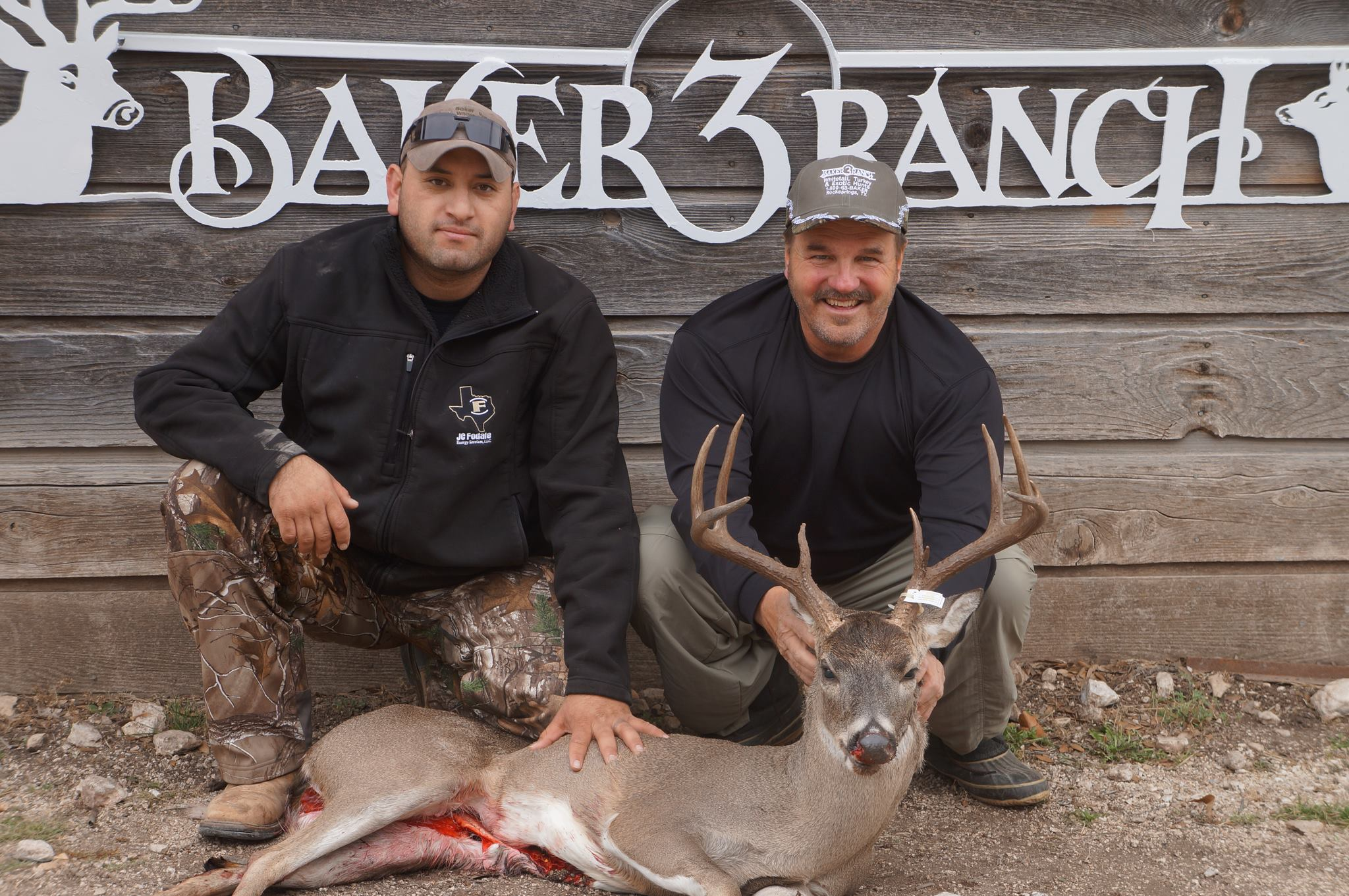 2 hunters and whitetail deer during deer hunt